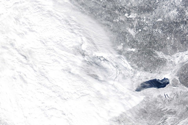 The great lakes are now frozen enough for a plane to land on the ice