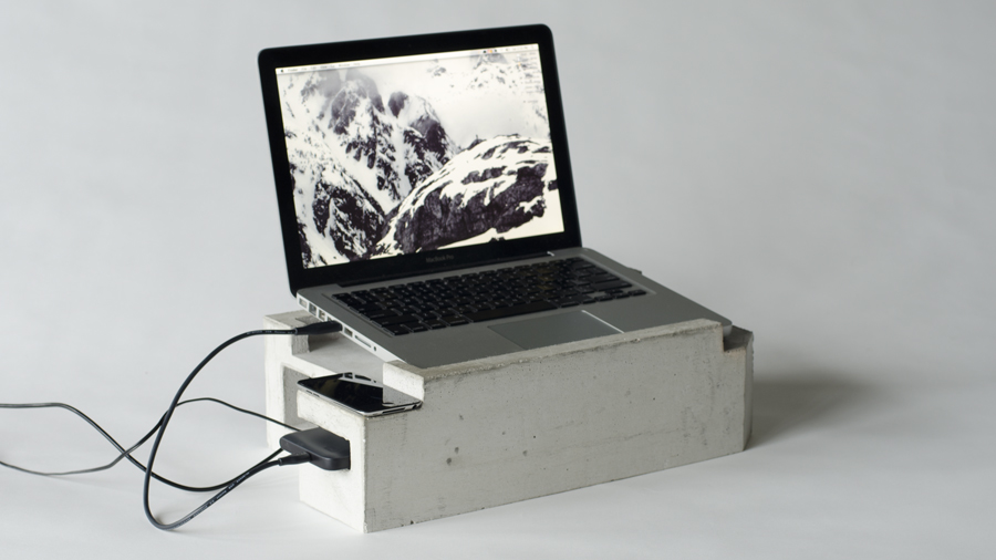 Your Metal Laptop Deserves a Throne of Concrete