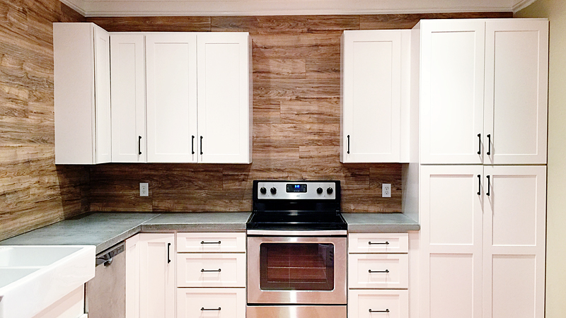 Use Laminate Flooring as a Durable, Easy to Clean Backsplash in Your Kitchen