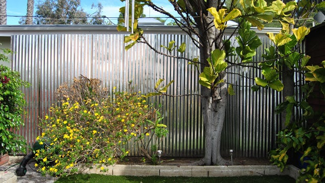 raise your backyard wall height for privacy and protection lifehacker australia. Black Bedroom Furniture Sets. Home Design Ideas