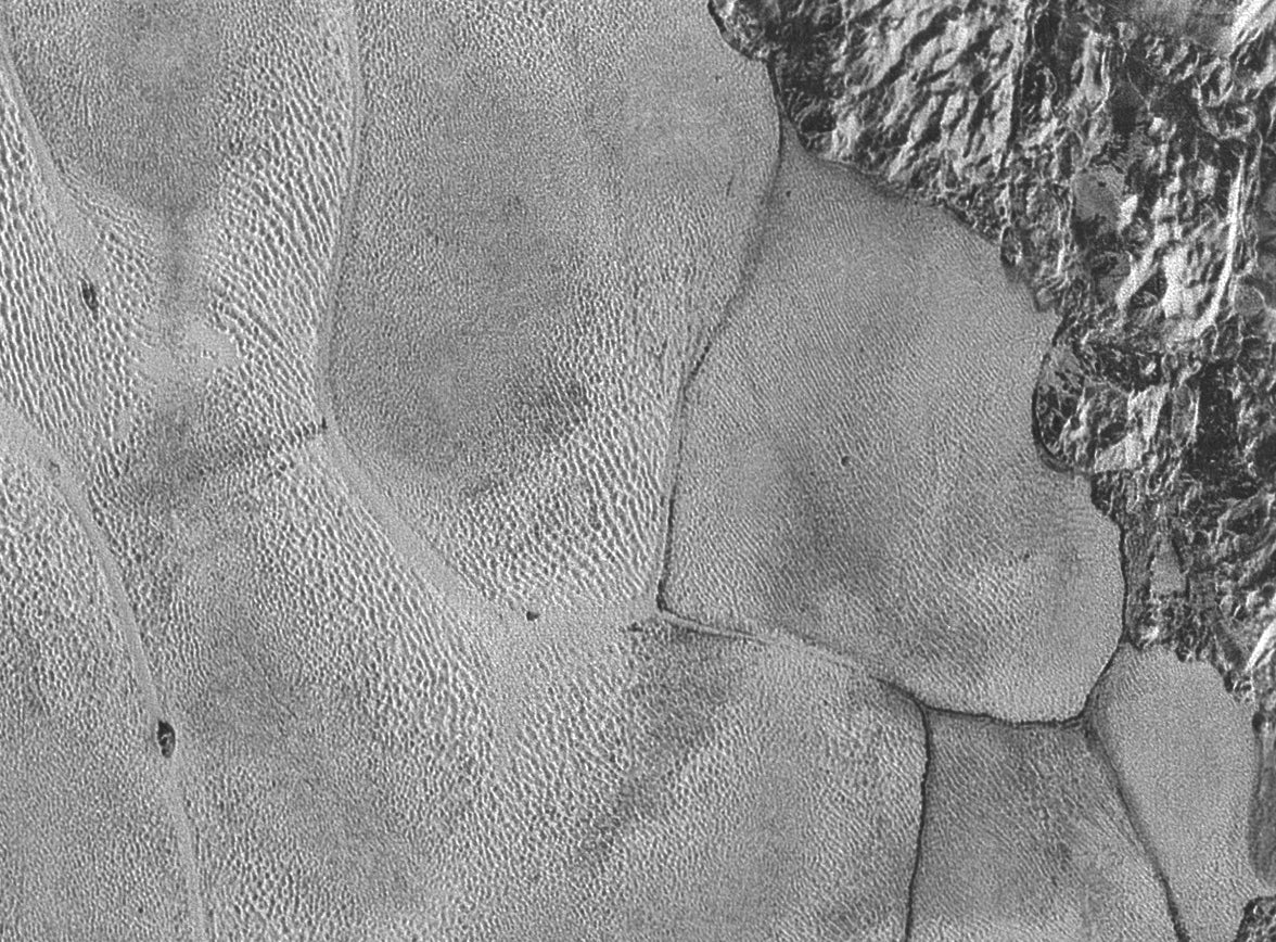 NASA's New Photos Bring Pluto's Surface Into Sharp Focus