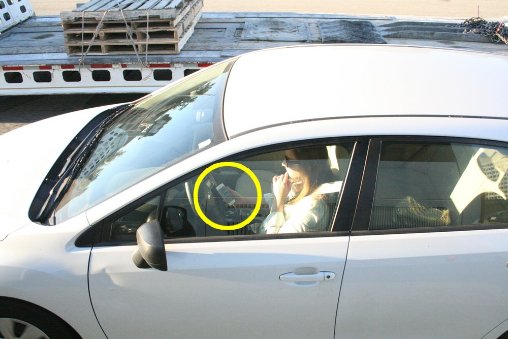 Another driver with phone on hands while driving