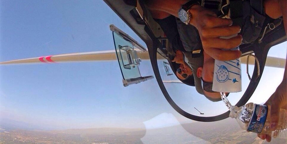 Cool Photo Of A Guy Pouring Some Water In An Inverted Plane