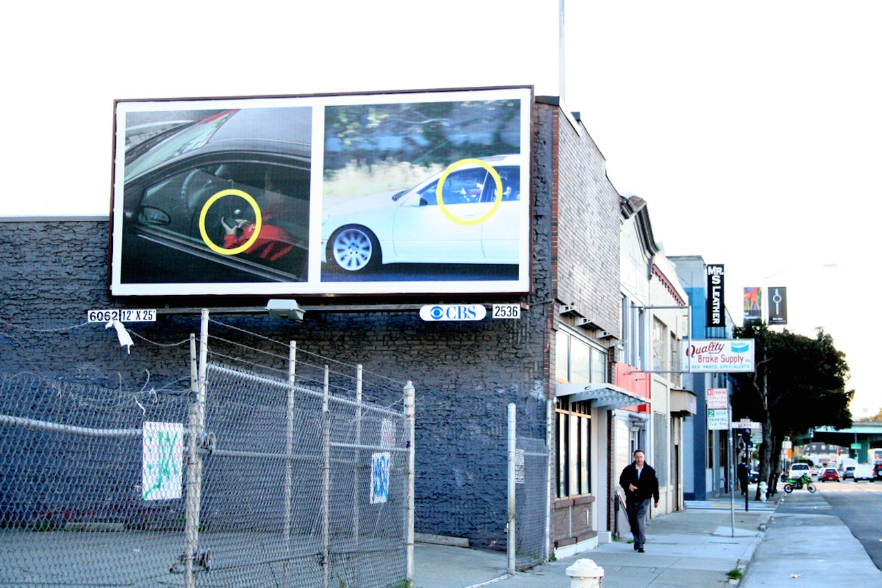 Another billboard showing drivers who text and drive