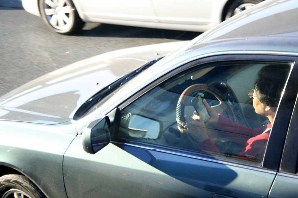 driver with phone while driving