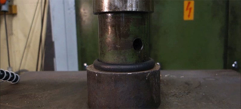 Hockey Pucks Are Tiny Bombs Waiting to Be Smooshed by a Super-Strong Hydraulic Press
