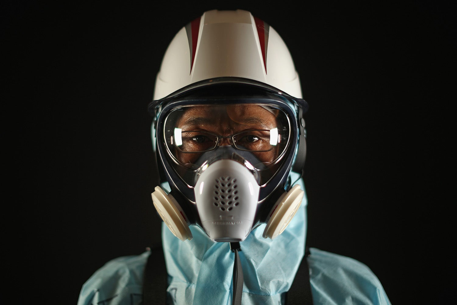 Fukushima Workers Don Their Protective Gear in These Eerie Portraits From the Exclusion Zone