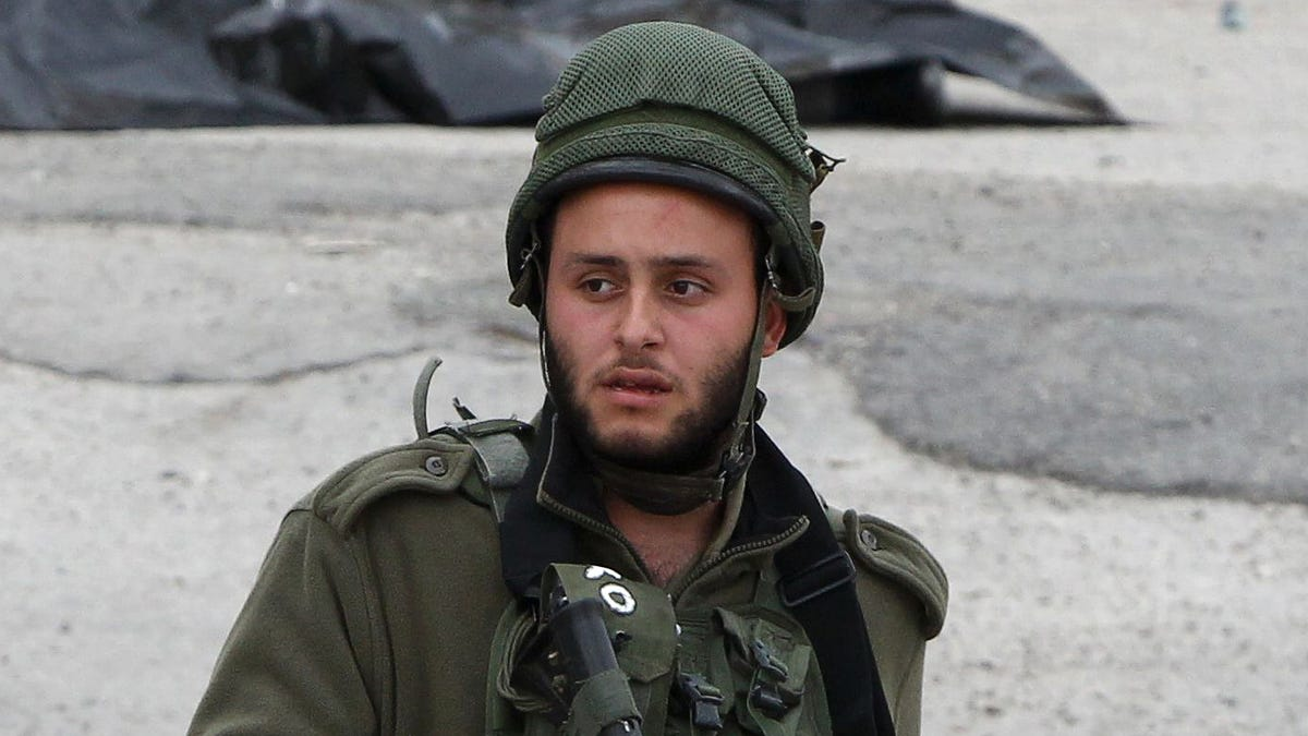 Patrolling West Bank Just Not Same Without Big Cone Of Chunky Monkey In Hand - the onion