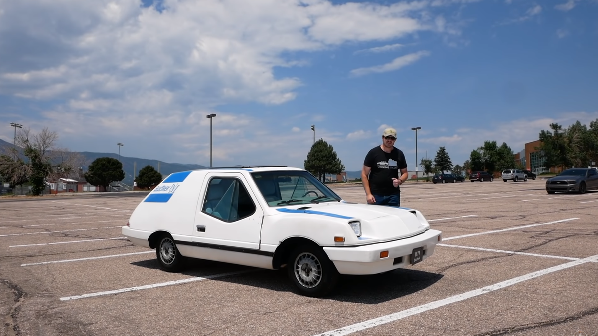 This Ridiculous Crap-Era EV Uses A Hair Dryer As A Window Defroster