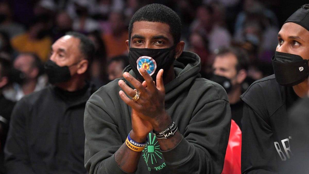 Kyrie Irving and Dave Chappelle are being used as Black 'pawns' on a white chessboard