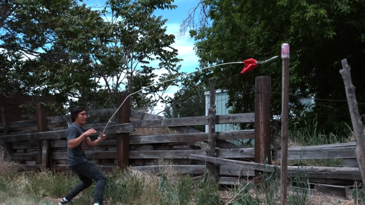 Rope dart maestro engages in mortal kombat with soda cans