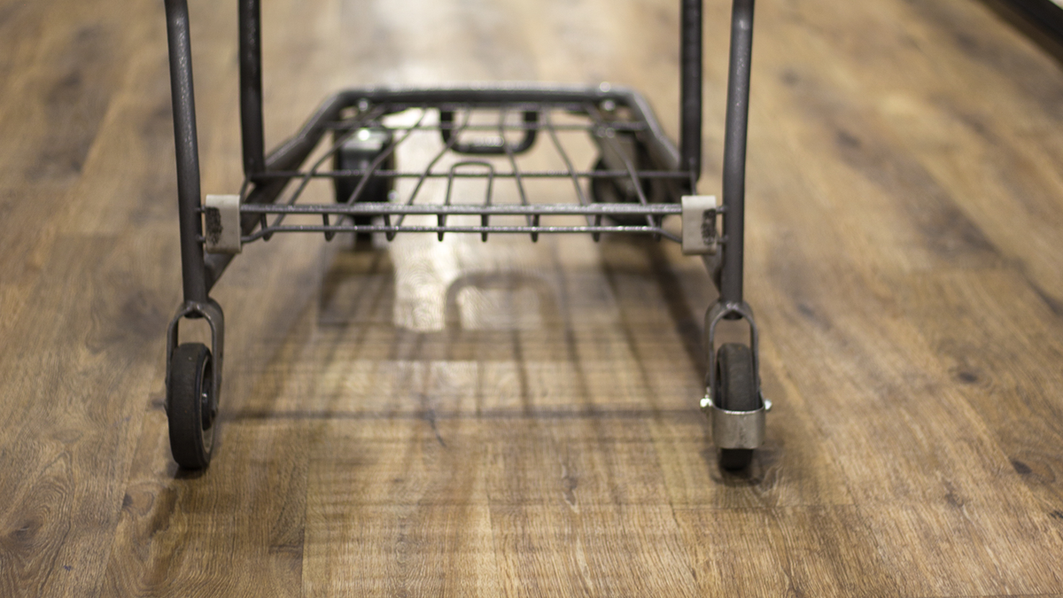 Vinyl Wood Floor Transports Woman From Supermarket Into Bazaar Of Epicurean Delights