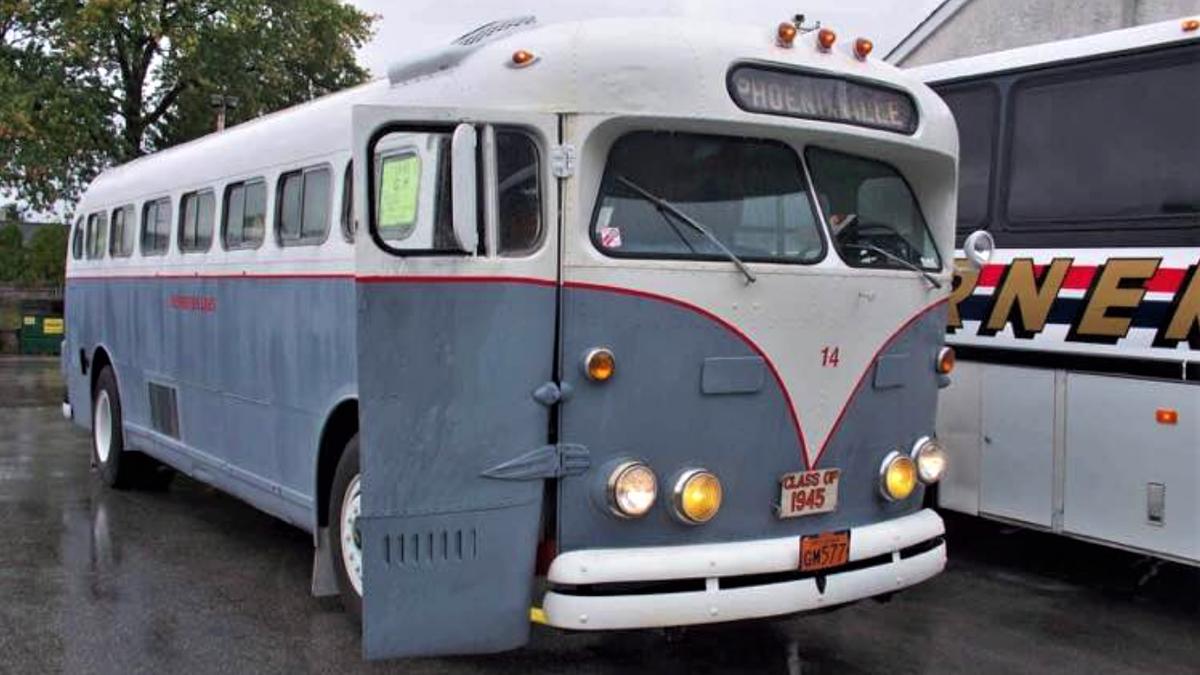 This Vintage GM Coach Bus Is A Retro RV With A Mini Hot Tub