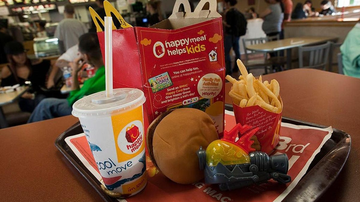 """Man builds """"Happy Meal House"""" for his 20,000+ fast food toys"""