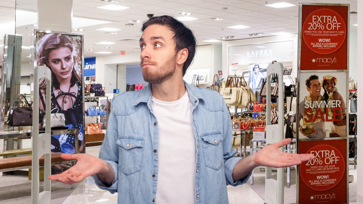 Man Exiting Store While Alarm Sounds Makes Big Show Of Looking Surprised To Appear Innocent