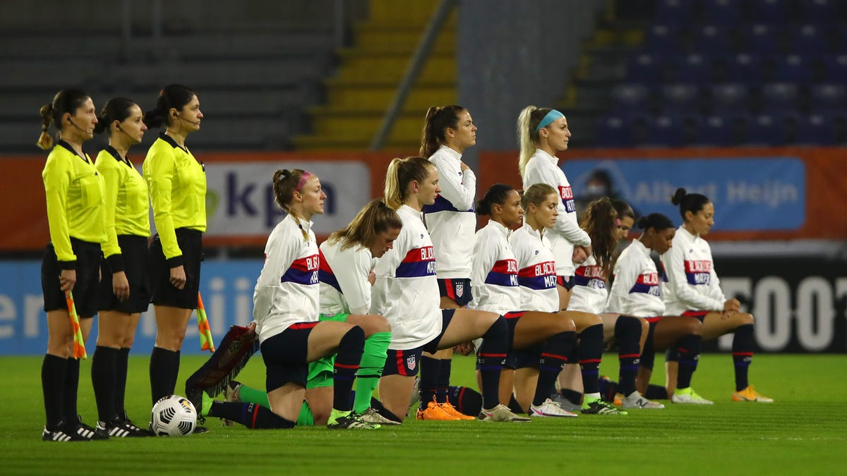 USWNT takes knee, dons Black Lives Matter jackets in solidarity 'to affirm human decency'