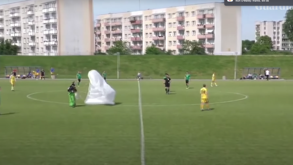 SEE IT: Parachuter lands in the middle of Polish soccer game, draws yellow card