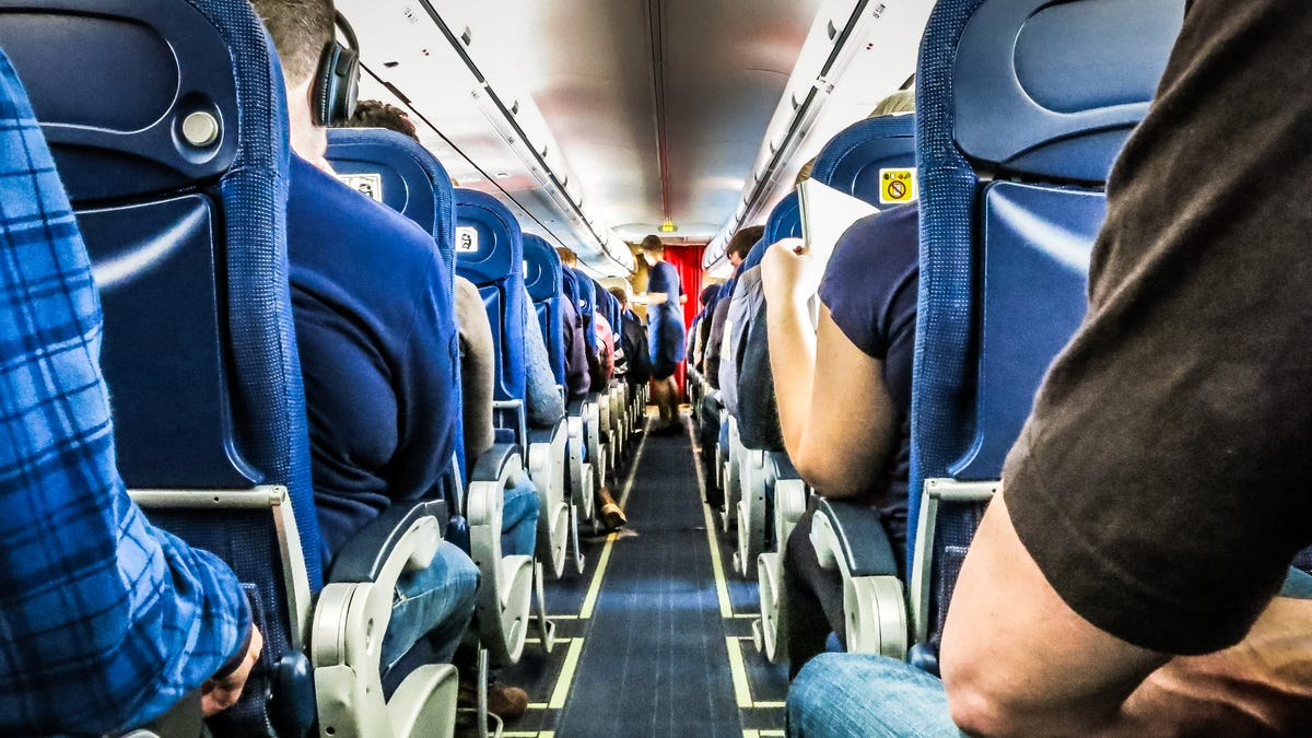How to Survive Sitting on a Long Flight, According to a Physical Therapist