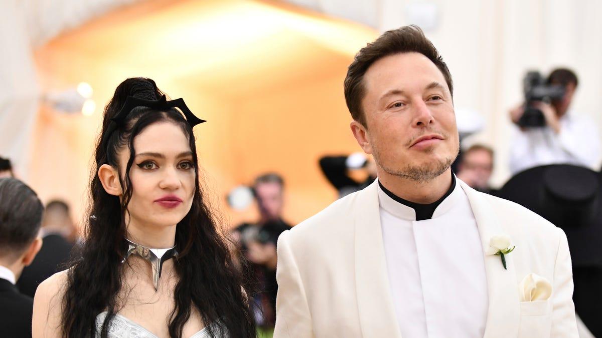 Elon Musk Dressed As Both James Bond And A James Bond