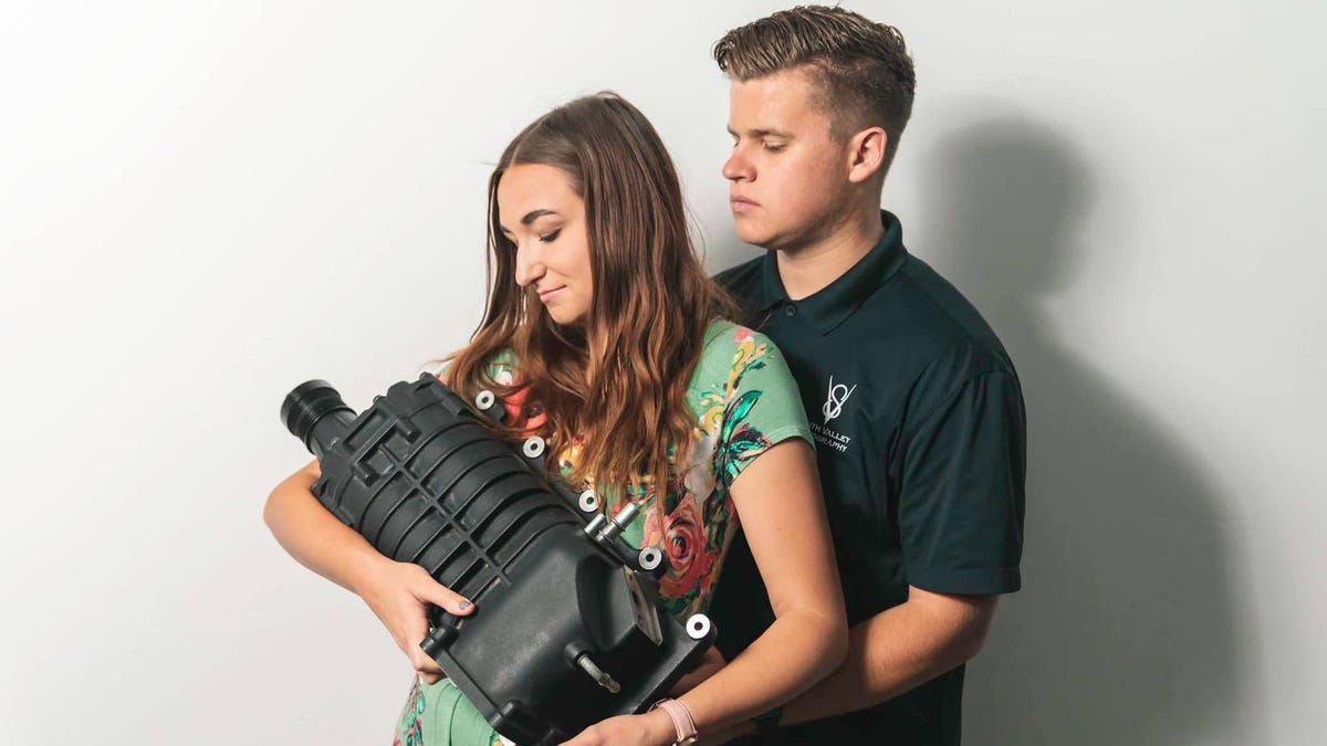 Couple Takes Baby Pictures with Supercharger After Mom Pressures Them for Grandchildren