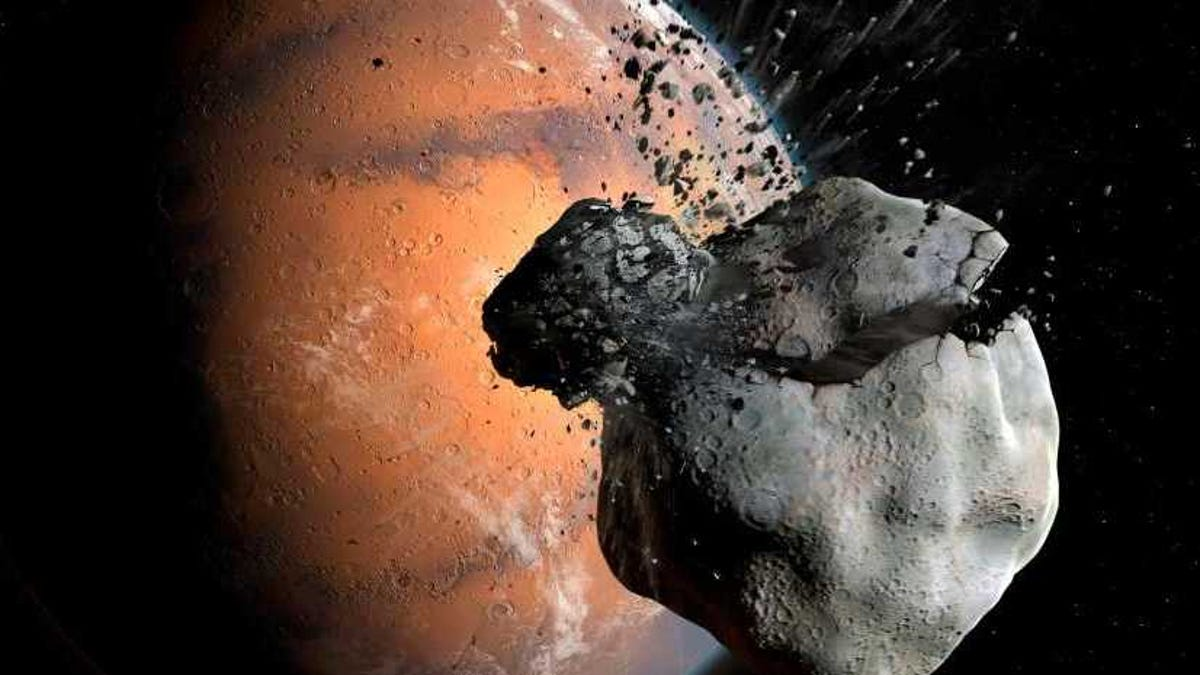 Computer Simulations Suggest Martian Moons Were Separated at Birth