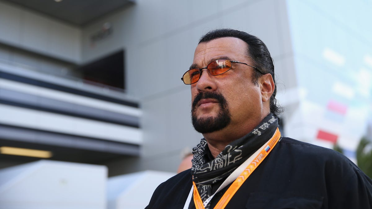 Steven Seagal runs like a small toddler with noodles for arms
