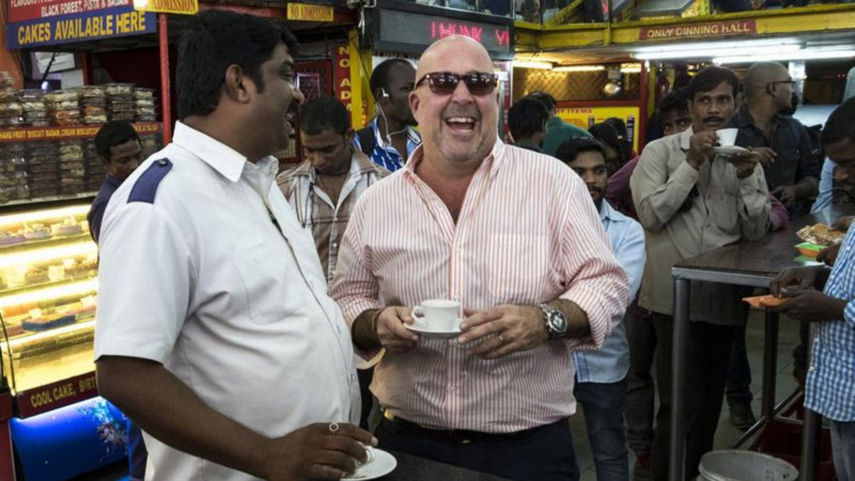 Andrew Zimmern trades in bizarre foods for taxicabs with Driven By Food