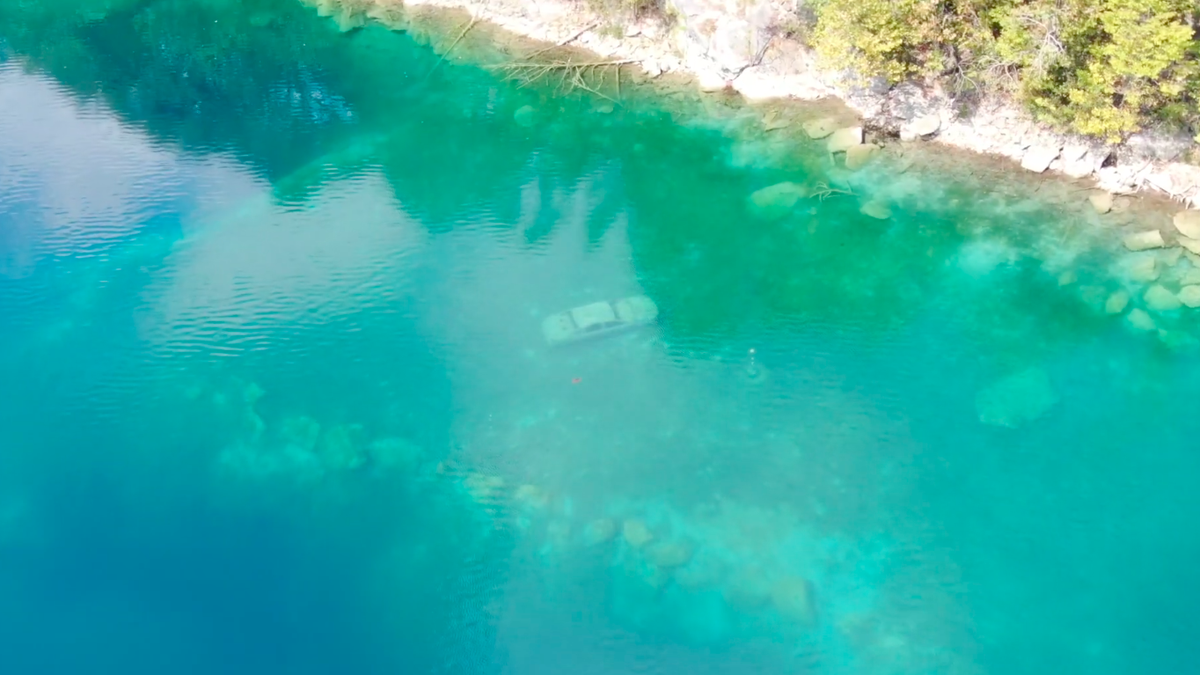 Watch Divers Explore An Underwater Playground Of Cars And Boats