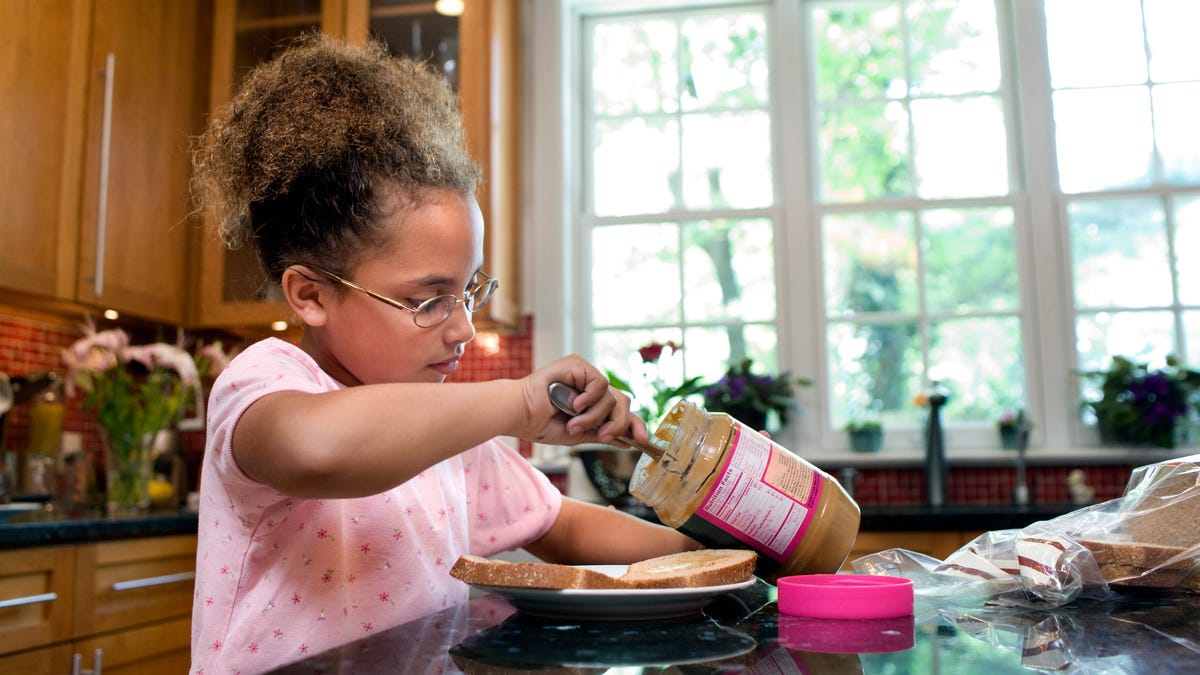 Why do peanut butter jars have those hard-to-scrape rims?