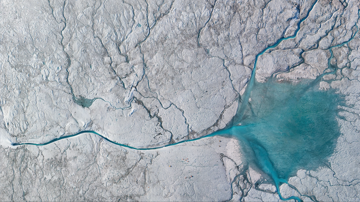 Hundreds of Glacial Rivers Pouring Into the Belly of Greenland's Ice
