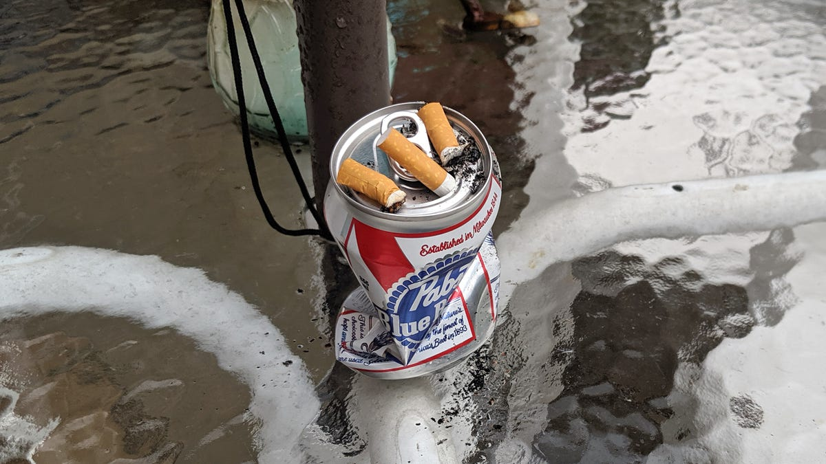 Grizzled Beer Can Used As Ashtray Watches Another Headstrong 12-Pack Come And Go Through Patio