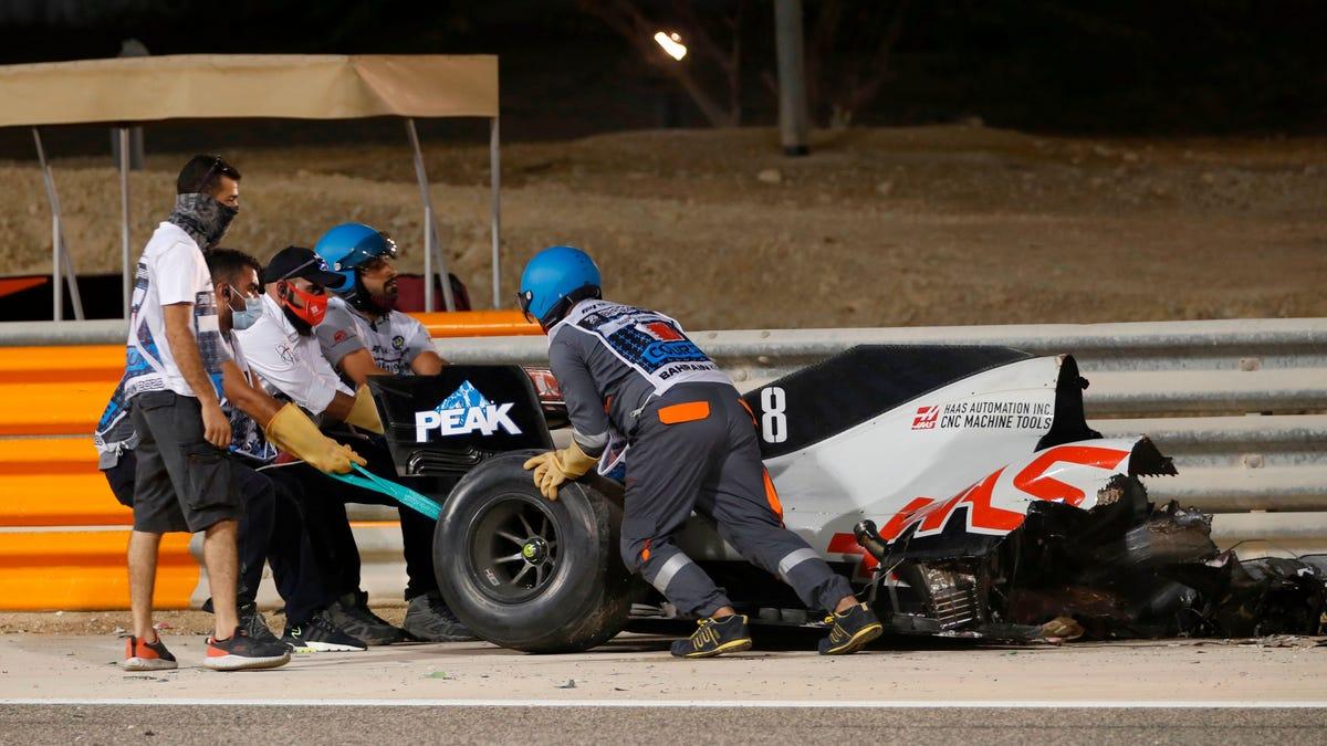 Haas Driver Romain Grosjean's F1 Car Goes Up In Flames, Spears Through Barrier, Splits In Half. Grosjean Walks Away