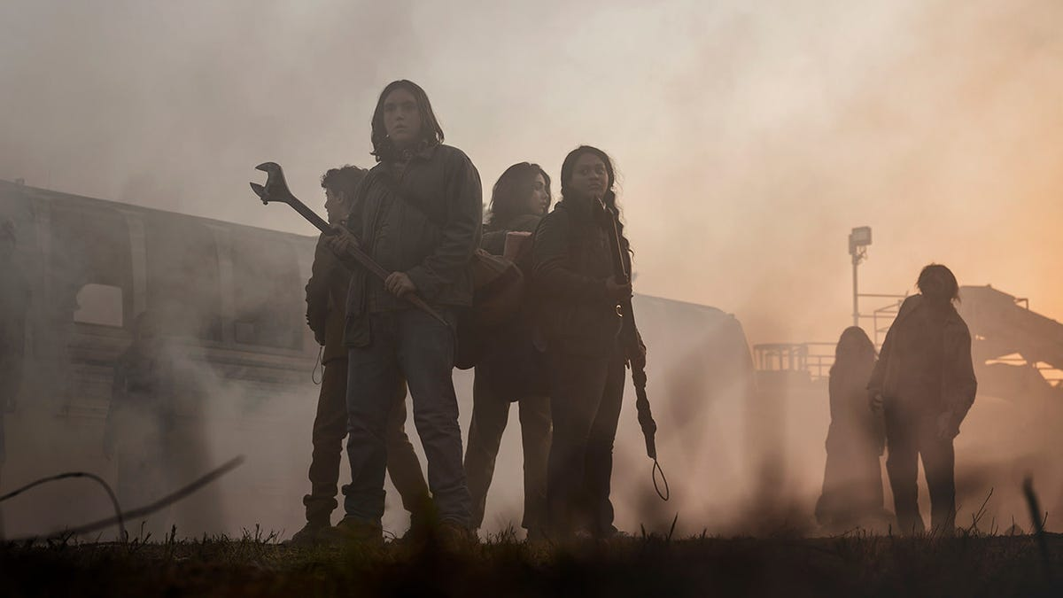 A New Walking Dead: World Beyond Trailer Hits the Road and Fights Some Zombies