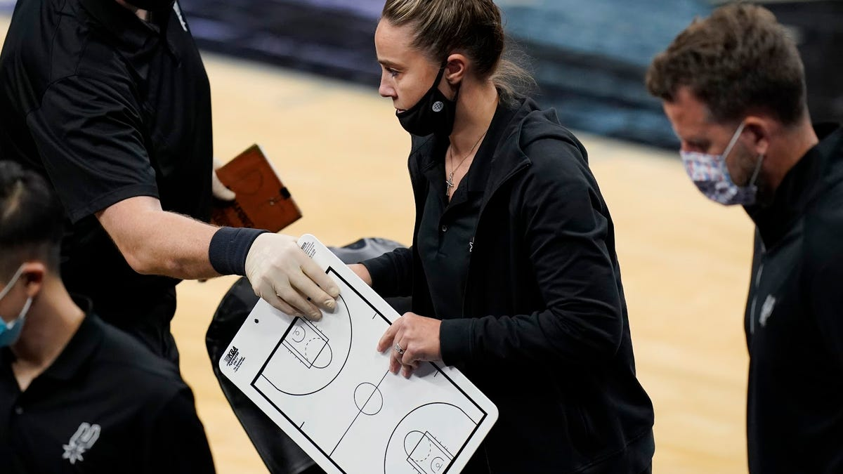 Becky Hammon, long overdue for a head coaching job, makes history as Popovich gets tossed from game