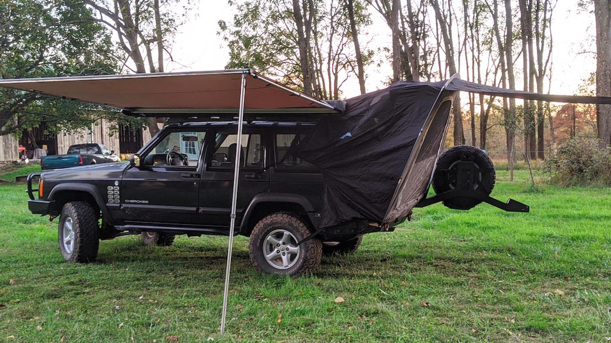 Hero Saves Official Pontiac Aztek Tent From Junkyard Installs It On His Jeep Cherokee Xj