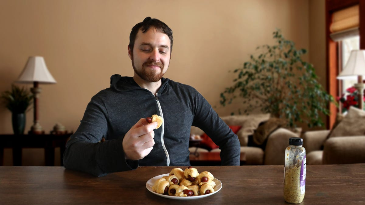 Self-Loathing Slowly Morphing Into Pride As Man Consumes 36th Pig In A Blanket