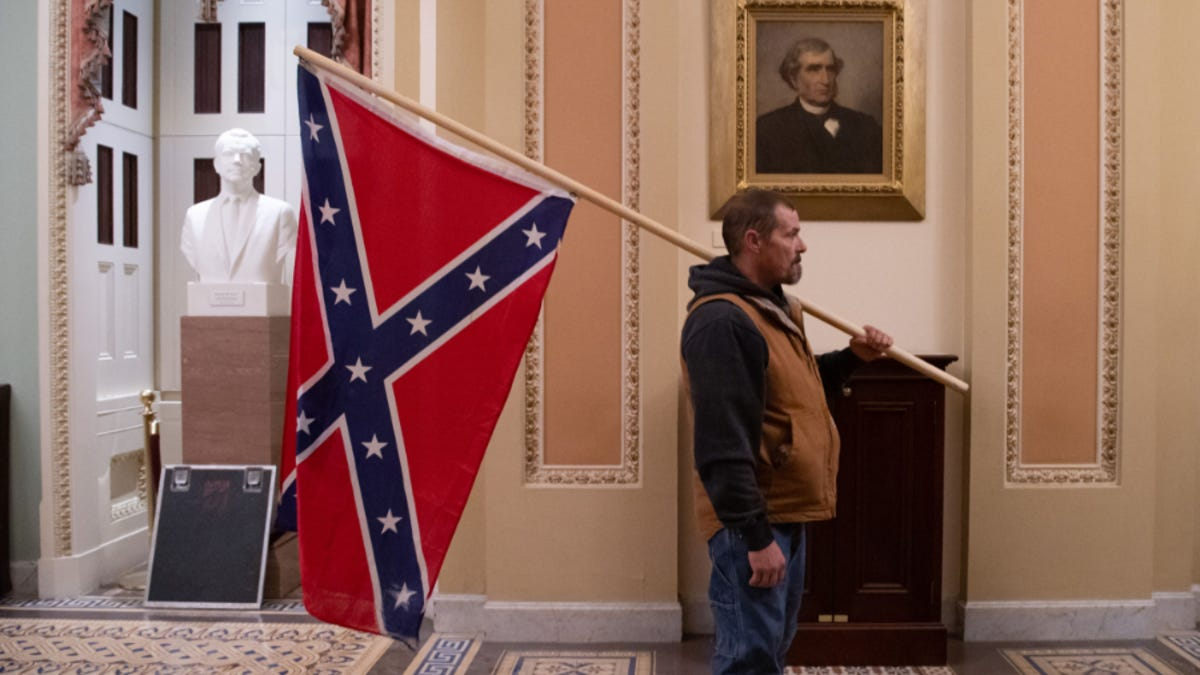 More Capitol Rioters Arrested, Including Man Pictured With Confederate Flag Inside Capitol Building
