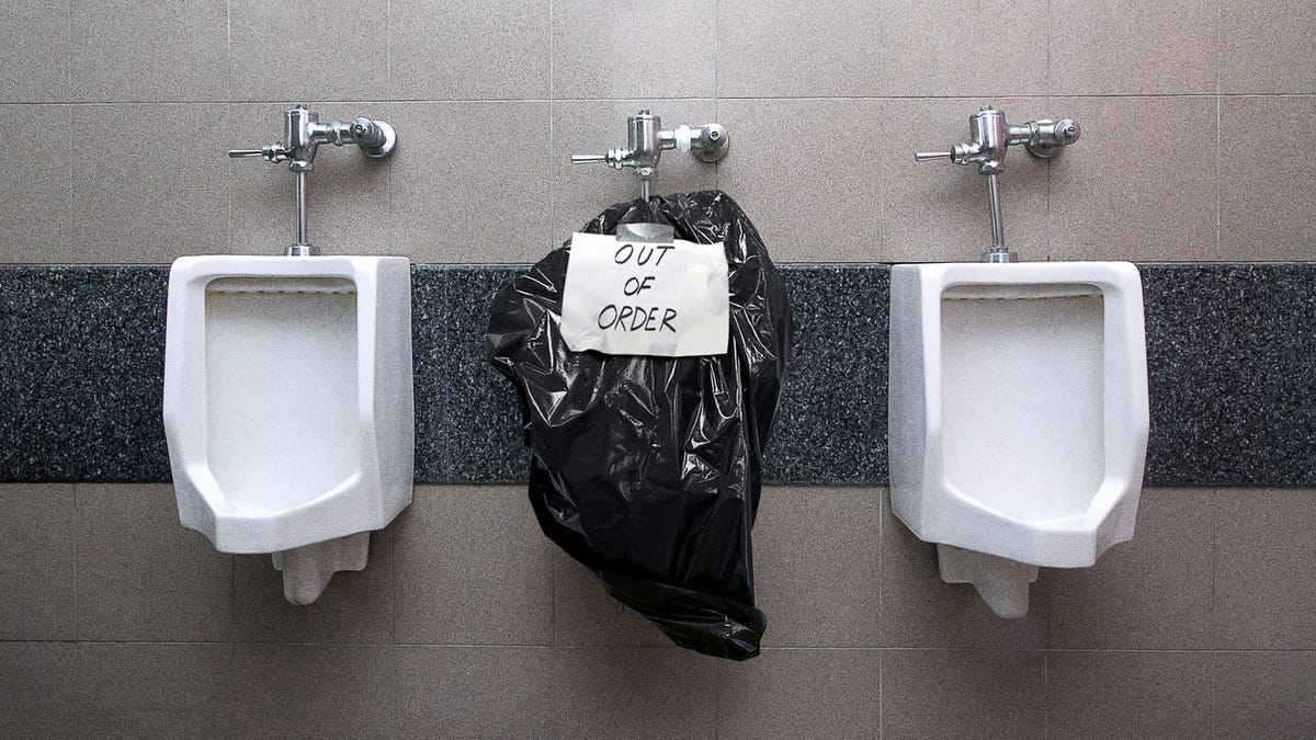 Handwritten Sign Clarifies Flooded Urinal Covered In Garbage Bag 'Out Of Order' - the onion
