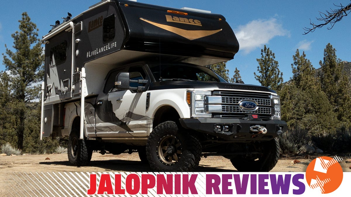 A Ford F-350 With Huge Tires And A Lance 855S Camper Makes A Comfy Portable Home