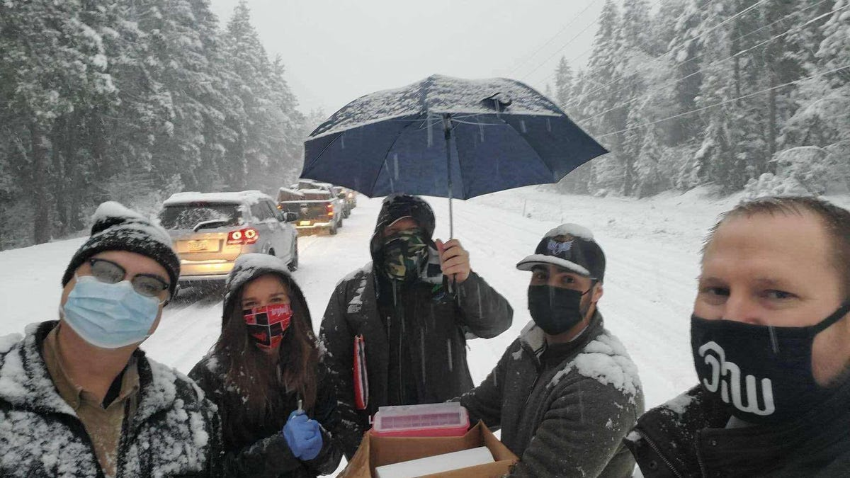 Health Care Workers Give COVID-19 Vaccines To Motorists Stranded In A Snowstorm