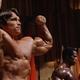 Screenshot of Arnold Schwarzenegger posing from Pumping Iron