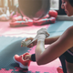 woman wrapping her hands at a boxing gym