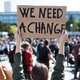 """protest sign: """"we need a change"""""""