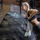 woman flipping a tire in the gym