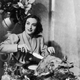 Joan Crawford carves a turkey for a 1930 publicity shot.
