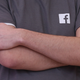 File photo of a Facebook employee wearing a t-shirt with a Facebook logo