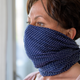 person wearing a scarf over her face