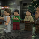 A screenshot from the LEGO Star Wars Holiday Special showing Finn, Rey, and Chewbacca