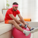 guy looking bored with exercise equipment