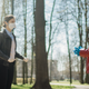 people talking in a park with masks